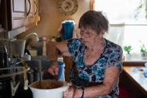Local Norwegian lapp women making a traditional local dish.