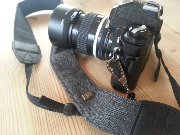Camera strap with clasps