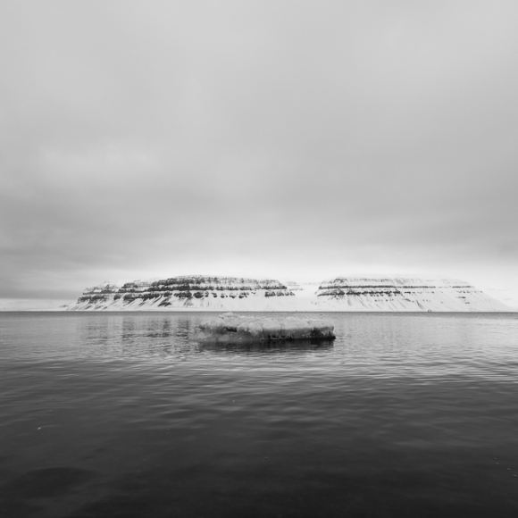 This was shot on the banks of Tempelfjorden,Svalbard in April. Normally the fjord would be frozen at this time of year, and it would be possible to cross it and get to the glacier on the other side. However, our expedition was abruptly stopped by the liquid water and we had to admire the glacier from a distance this time. Shot with Canon 5Ds and Canon 17-40mm f/4L USM @ 17mm, 1/125sec, f/8, ISO 50
